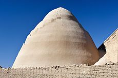 """Yakhchāl - Wikipedia Yakhchāl(Persian:یخچال """"ice pit"""";yakhmeaning """"ice"""" andchālmeaning """"pit"""") is an ancient type ofevaporative cooler. Above ground, the structure had a domed shape, but had a subterranean storage space; it was often used to store ice, but sometimes was used to store food as well. The subterranean space coupled with the thick heat-resistant construction material insulated the storage space year round. These structures were mainly built and used inPersia."""