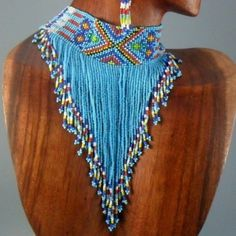 Necklace of blue seed beads with a beaded collar in a gorgeous Southwestern influenced pattern.