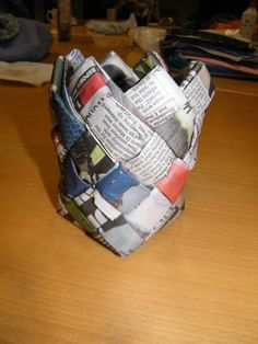 So cool! Small container from old newspapers.