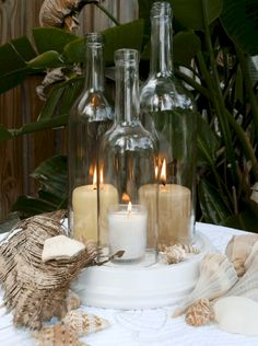 Wine Bottle Candle Holder Hurricane Lamp (diy flower arrangements with candles) Wine Bottle Candle Holder, Wine Bottle Centerpieces, Wine Bottle Art, Diy Centerpieces, Wine Bottle Crafts, Wine Bottles, Candle Holders, Glass Bottles, Cut Bottles