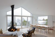 A Modern Finnish Villa That Grows Out of a Seaside Cliff - Photo 4 of 12 - Dwell Living Room Modern, Living Spaces, Hanging Fireplace, Light Hardwood Floors, Villa, Interior Decorating, Interior Design, House And Home Magazine, White Decor