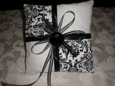 Cute ring bearer pillow to match the flower girl basket  for a black and white wedding theme.