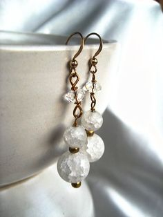 These handcrafted earrings feature spheres of ice flake (sometimes called ice crackle) quartz. These are created by superheating quartz