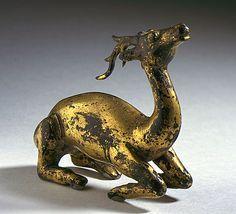 xx..tracy porter..poetic wanderlust...- China  Kneeling Deer, Tang dynasty, 618-906  Sculpture; Metalwork; Bronze, Cast bronze with gilding