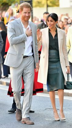 Prince Harry and Meghan Markle visit their namesake county of West Sussex. The Duchess of Sussex opted for a green Hugo Boss leather skirt and blouse. Prinz Harry Meghan Markle, Meghan Markle Prince Harry, Prince Harry And Megan, Fashion Looks, Beauty And Fashion, Royal Fashion, Fashion 2018, Style Fashion, Fashion Outfits