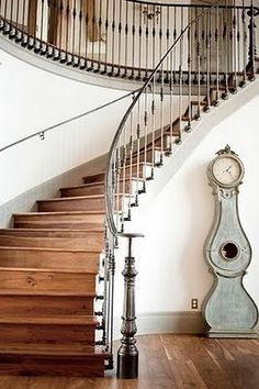 I love the iron balusters connected to the stringer as opposed to the tread