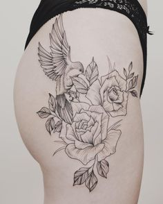 Delicate tattoo - bird and flowers