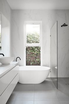 Minimalist Bathroom 282741682842934955 - Archive Of Caulfield House In Melbourne By Pleysier Perkins Source by meganpgray Laundry In Bathroom, Bathroom Renos, White Bathroom, Bathroom Renovations, Master Bathroom, Home Remodeling, Bathroom Ideas, Small Bathroom With Bath, Bathroom Cabinets