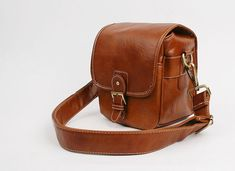 Hand Stitched Small DSLR Camera Bag in Retro Brown can carry one set of DSLR Camera perfectly. $65.00, via Etsy.