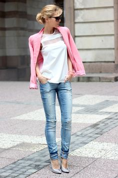 pink blazer and blue ripped jeans