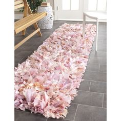This hand-woven runner rug adds trendy style to any space. The two-inch pile in shades of pink gives a whimsical yet luxurious feeling, and the polyester construction and cotton foundation ensures that this rug will stand up to years of wear and tear.