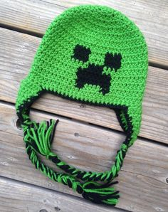 This Minecraft Creeper Inspired Hat is perfect for any Mincraft fan! This hat is great for everyday wear, as a gift or as a photo prop. Its hard to resist this popular Creeper hat. Super cute! Super fun! Perfect for all ages! Sizes available- circumference around head  0-3 months: fits up to 16 ($18) 3-6 months: fits up to 17 ($18) 6-12 months: fits up to 18 ($20) 12-24 months: fits up to 19 ($20) Toddler (2-5 yrs): fits up to 20 ($22) Child (5 yrs and up): fits up to 21 ($22) Teen/Small…