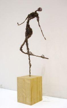 Suzy Hunziker sculpture  http://www.artspacewarehouse.com/artists/SuzyHunziker.html
