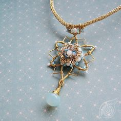 Necklace Snowflake; brass, labradorite, apatite, chalcedone; wire-wrapping and viking knit; by Nady