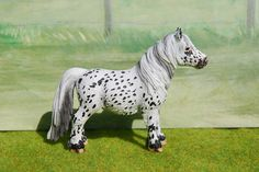 This pony was turned into a British Spotted Pony and a Black Leopard Appaloosa cross, from a Shetland Pony. Dinx, a gelding, is another pony that will be gleefully added to the Schleich Ranch! His former colors were of a mixture of light gray and black.
