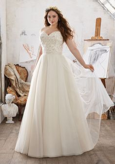 Julietta Collection by Morilee: Designer Wedding Dresses and Bridal Gowns by Morilee. This Plus Size Net Ballgown Features a Delicately Beaded and Embroidered Sweetheart Neckline.