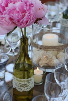 Repurposing an old wine bottle, wrapped with lace, for a vase...pretty centerpiece.