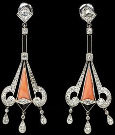Platinum, coral, black onyx and diamond earrings, circa 1925.