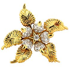 Tiffany & Co. Jean Schlumberger Diamond Gold Platinum Flower Brooch | From a unique collection of vintage brooches at https://www.1stdibs.com/jewelry/brooches/brooches/