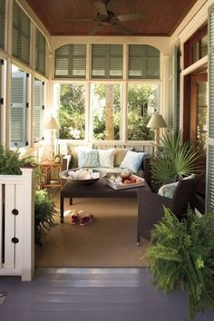 Beadboard wood ceilings, white trimmed windows, green shutters and grey floor