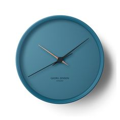 Infuse your home with the contemporary design of this Henning Koppel clock from Georg Jensen. In a stylish matt blue, this clock has plain unmarked face and is made from stainless steel. With matching