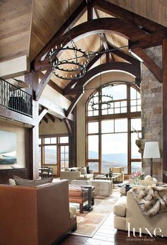 View of living room in a classic alpine home in Beaver Creek Colorado where contemporary forms meet Iconic Western materials and decor. Interior Design - Eddy Doumas, Architecture - Eric Johnson