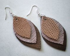These leather earrings looks so simple!  I know I could find some thrifted leather purses...
