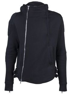 Biker jacket in black from Balmain. This cotton jacket features a high neckline, an off-centered diagonal silver zipper, side pockets, and long sleeves with long zippers at the cuffs. Has silver D-ring belt detail on the sides of the hem, padded detail on the sleeves, and a hood.