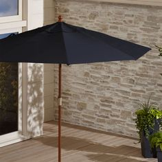 Shop 9' Round Sunbrella ® Dark Navy Patio Umbrella with FSC Eucalyptus Frame.  This oversized outdoor patio umbrella in fade- and mildew-resistant Sunbrella acrylic blocks out 98% of the sun's UV rays.