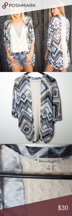 Love On A Hanger Open Drape Cardigan Sweater Adorable sweater from Love On A Hanger. Open front drape cardigan. Good preloved condition. Cream crochet strip down the back. Pattern includes grey, white, yellow and blue graphics. 94% polyester, 6% spandex. Machine wash cold, tumble dry low, cool iron if needed. love on a hanger Sweaters Cardigans
