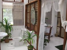 """Sonya's Garden B: bath / toilet area is only separated by """"open dividers"""" to the other parts of the room. Very uni Modern Filipino Interior, Filipino Architecture, Filipino House, Old House Design, Tropical Beach Houses, Philippine Houses, Tropical Interior, Spanish House, House Layouts"""