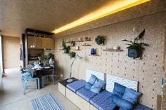 The container interiors are made almost entirely out of ECOboard, a low-energy material made out of pressed grass