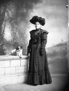 Studio portrait of Mrs Coley wearing a full length dress, gloves and a hat with feathers. She is photographed with a dog. Taken by James McAllister. Dog Portraits, Studio Portraits, Old Dogs, New Zealand, Goth, Gothic, Professional Headshots, Goth Subculture