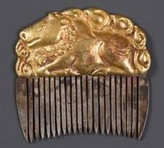 Vietnam 10th - 11th century,  Cham Dynasty  embossed gold plate on a toothed silver plate, set with stones.
