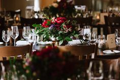 Red peony and foliage centrepiece in a gold pedestal vase for a Calgary Wedding at @bvrrestaurant Photo by Abby  Plus Dave  www.flowersbyjanie.com  Calgary Wedding Florist