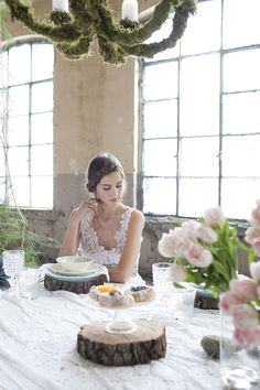 #moss #tabledecor #woodenslice set up by @VIOLAMALVA FLOWERS and dress by @CHIANTI HOME by Tramediluna Tuscan handmade home textiles items and woman clothing photo by @Michela Melotti