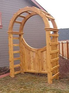 gate with arbor -- would be great with some flowering vines or roses growing over the arbor