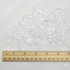 White Embroidered Floral Matte Sequin Lace Fabric by LaceFabrics