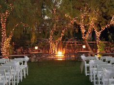 My ceremony will be romantic and entrancing lit up by trees of christmas lights while the couple say their vows at sunset