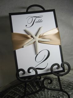 elegant beach wedding images: maybe silver and blue instead Beach Wedding Tables, Card Table Wedding, Wedding Table Numbers, Beach Weddings, Wedding Images, Our Wedding, Destination Wedding, Wedding Planning, Wedding Ideas