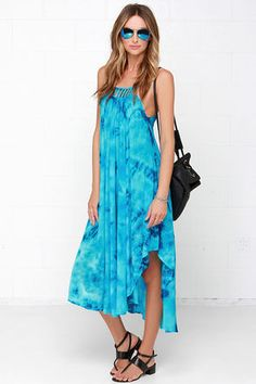 We all know the ocean calls, so why not listen? Get comfy and cute in the Tied to the Tide Blue Tie-Dye Midi Dress! Beautiful shades of blue adorn woven rayon in a classic tie-dye print, shaping a caged neckline with adjustable spaghetti straps. The trapeze cut ends at a midi length in a deep, convex hem. Unlined. 100% Rayon. Hand Wash Cold. Imported.