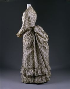 Dress Date: 1880s Culture: British Medium: cotton Dimensions: Length at CB (a): 54 1/2 in. (138.4 cm) Length at CB (b): 41 in. (104.1 cm) Credit Line: Gift of The New York Historical Society, 1979 Accession Number: 1979.346.43a, b