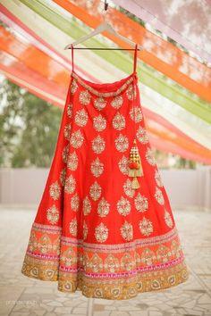 Impressive orange designer wear lehenga with zari ,kundan work all over the lehenga.