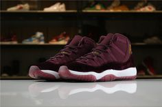 Air Jordan 11 Heiress Red Velvet Night Maroon Metallic Gold 852625-650 For Sale  Essentially a lifestyle-inclined iteration of the iconic basketball sneaker, the model is defined a premium material construction consisting of nubuck, leather and velvet across its entire upper. The vibrant red hue is complemented with accents of metallic gold via branding to further exude its luxurious makeup. Finally, a crisp white midsole unit and maroon translucent outsole finishes off the overall profile. Jordan 11 Red, Nike Air Jordan 11, Retro Sneakers, Sneakers Nike, Sneaker Games, Basketball Sneakers, Trendy Shoes, Red Velvet, Air Jordans