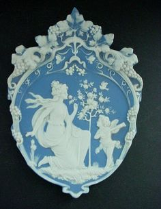 *GERMAN JASPER WARE ~ Plaque Woman with Cupid or Angel, is is stamped Germany on th back side and is done in the manner of Volkstedt or Schafer & Vater.
