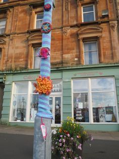 Giant crochet flowers referencing the traditional floral stonework on Duncan's Halls building, recipient of Rothesay THI regeneration funding