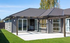 Gardner home has a lovely patio accessible from the main lounge. Traditional Home Exteriors, Traditional House, James Hardie, Small Houses, Cladding, Villa, House Ideas, Lounge, House Design