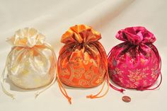 """Oriental Floral Satin Handbag Set - 3 pack - Fuchsia, Melon, Ivory - jewelry pouch / bag, money bag, gift bag, evening/prom/bridal wedding handbag. Three BEAUTIFUL shining floral design heavy satin handbags. Flat bottom, completely lined inside, closes with double satin china cord. 5"""" in diameter, 4"""" high below pull cord. Each item is individually packed in clear cello bag. Fashionable and trendy wedding/party accessory. May be used as jewelry pouch, jewelry bag, money bag, gift bag..."""