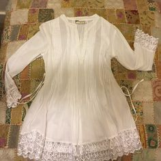 Magazine White Blouse Beautiful doesn't do this blouse justice!! I bought it from another posher who listed it as free people, it is gorgeous details throughout. In Excellent Condition Magazine Tops Blouses