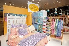 A bed in a craft show booth, that stands out!